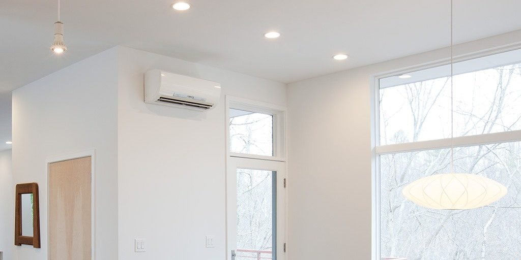 white ductless heat pump on white wall | Solve Heating problems with ductless mini splits | Kansas City| AB May
