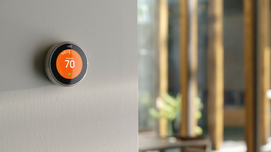 nest thermostat on gray wall | benefits of nest thermostat technology for Kansas City homeowners | AB May Heating and Cooling